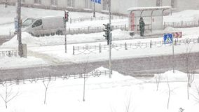 Car traffic in winter city. Urban scene of city life in winter seson. Safety on the road in winter stock footage