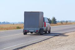 car with the trailer goes on highway Stock Image