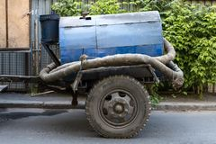 Old mobile trailer with a water pump. royalty free stock photos