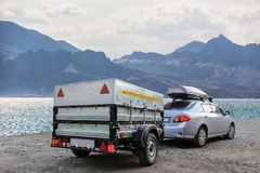 Car trailer by the sea. Car trailer and roof rack by the sea royalty free stock photos