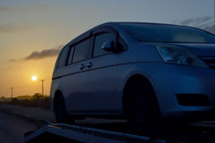Car on a trailer at sunrise Stock Image