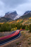 Car Trails Going up a Mountain Road during a stormy cloudy morning. Car Trails Going up Bear Lake road in Rocky Mountain National Park right before sunrise on a royalty free stock images