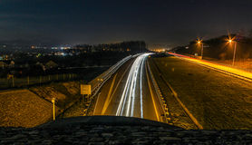 Car trails on highway Stock Photos
