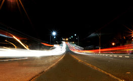Car Trails Light painting on an avenue. Long exposure of Valinhos/SP, Brasil of cars passing in an avenue and leaving light trails Stock Photos