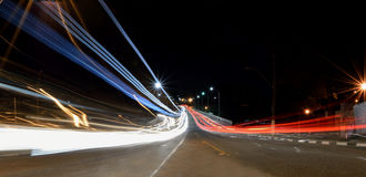 Car Trails Light painting. Long exposure shot of cars passing by a street Stock Image