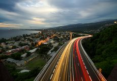 Light trail of cars on the tamarin road in Saint Paul, Reunion Island. Car trails on the tamarin road from above, in saint paul Royalty Free Stock Photography