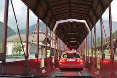 The car train going through the Tauern Railway Tunnel. The train ride from Mallnitz-Obervellach to Böckstein Bahnhof through the Tauern Railway Tunnel in Stock Photo