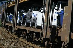 Car transport on freight wagons Stock Photos