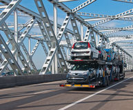 Car transport over an old Dutch bridge. Car transport over an old steel bridge in the Netherlands Stock Photo
