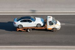 Car is transported on an evacuation tow truck on the highway. Car is transported on an evacuation tow truck on the highway royalty free stock photo
