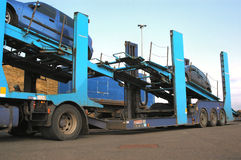 Car Transporter. A semi truck car transporter parked up with 2 cars onboard Stock Image