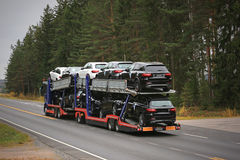 Car Transporter Truck Hauls New Cars on the Road Royalty Free Stock Images