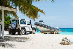 Car transporting motorboat on african beach Stock Image