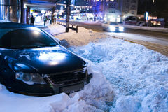 Car trapped in snow. After heavy winter snowfall along Magheru Avenue, Bucharest Stock Photo