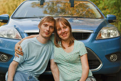 Car travel couple relax. Young couple relax near car Royalty Free Stock Images