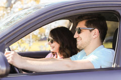 Car travel. Travel. Couple is traveling in the car Royalty Free Stock Photography