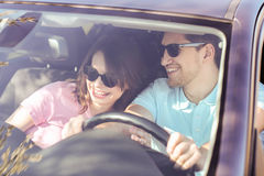 Car travel. Travel. Couple is traveling in the car Royalty Free Stock Photos
