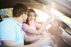 Car travel. Travel. Couple is traveling in the car Stock Image
