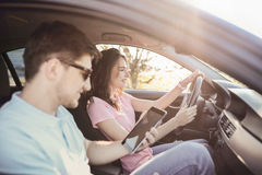 Car travel. Travel. Couple is traveling in the car Stock Photos