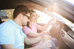 Car travel. Travel. Couple is traveling in the car Stock Images