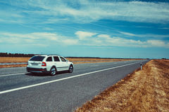 Car travel. On europe road. Blue sky and summer field panorama Royalty Free Stock Image