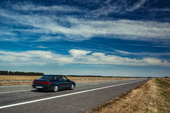 Car travel. On europe road. Blue sky and summer field panorama Stock Images