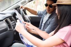 Car travel and road trip. Couple in car with map stock photos