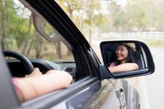 Car travel and road trip. Couple in car with map Royalty Free Stock Photos