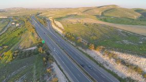 Car travel on vacation. Aerial shot of amazing green landscape, road traffic stock video