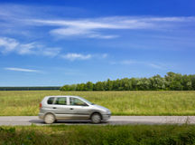 Car Traveling Along a Country Road Stock Photography