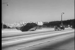 Car traveling on highway towards Golden Gate Bridge stock video footage