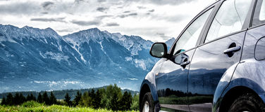 Car for traveling. With a mountain road Royalty Free Stock Images