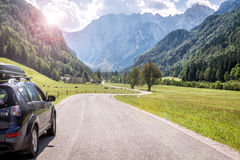 Car for traveling. With a mountain road Royalty Free Stock Photo