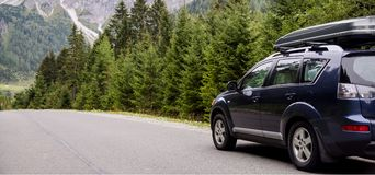 Car for traveling. With a mountain road Royalty Free Stock Image