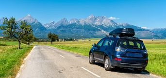 Car for traveling with a roof rack on a mountain road. In Slovakia. Tatry stock image