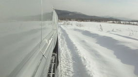 Car traveling on winter roads. Wheels of a car traveling on winter roads stock footage