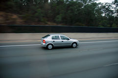 Car travelling. Single car going on highway, motion blur Royalty Free Stock Photography