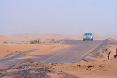 Car Travelling Across Desert Royalty Free Stock Photo
