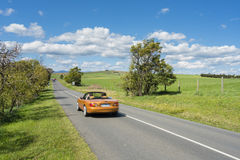 Car travelling on country road Stock Images