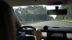 Car travelling on freeway through the forest stock footage