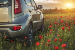 Car travelling. Vehicle on a nature field as  concept eco techno Stock Image