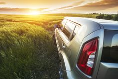 Vehicle on a nature field as  concept eco techno Royalty Free Stock Image