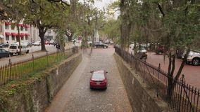Car Travels Up Narrow Cobblestone Savannah Street
