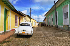Car in Trinidad street, cuba. Classic vintage american car in the streets of Trinidad town, cuba Royalty Free Stock Image