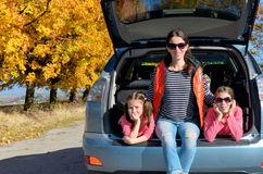 Car trip on autumn family vacation, happy mother and kids travel. And have fun, car insurance concept Royalty Free Stock Photos