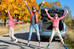 Car trip on autumn family vacation, happy mother and kids travel Stock Images