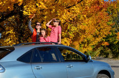 Car trip on autumn family vacation, happy mother and kids travel Stock Image