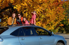 Car trip on autumn family vacation, happy parents and kids travel Royalty Free Stock Images