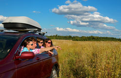 Car trip on family vacation. Happy parents and kids travel and have fun, car insurance concept stock images