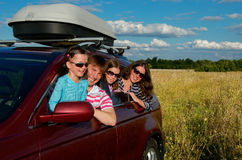 Car trip on family vacation. Happy parents and kids travel and have fun, car insurance concept royalty free stock photo